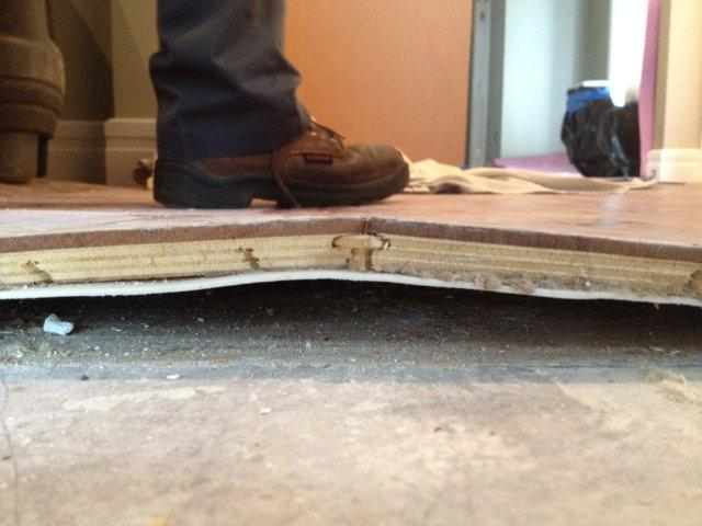 Water damaged wood floor lift from substrate